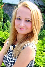 Ukrainian girl Lesia,26 years old with green eyes and blonde hair.