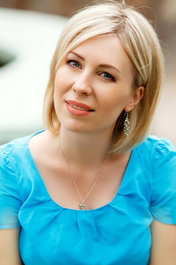Ukrainian girl Tatiana,39 years old with blue eyes and blonde hair.