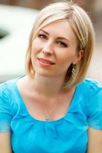 Ukrainian girl Tatiana,39 years old with blue eyes and blonde hair.