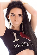 Ukrainian girl Elena,24 years old with blue eyes and black hair.