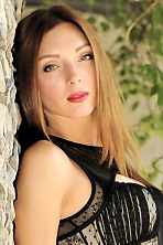 Ukrainian girl Irina,32 years old with green eyes and light brown hair.