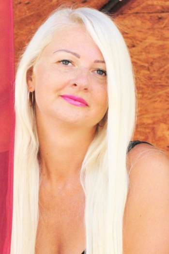 Ukrainian girl Liliya,40 years old with blue eyes and blonde hair.