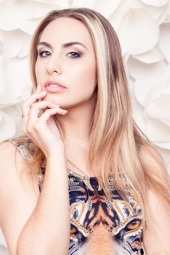 Ukrainian girl Olga,21 years old with grey eyes and blonde hair.