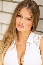 Ukrainian girl Anastasia,25 years old with grey eyes and dark brown hair.