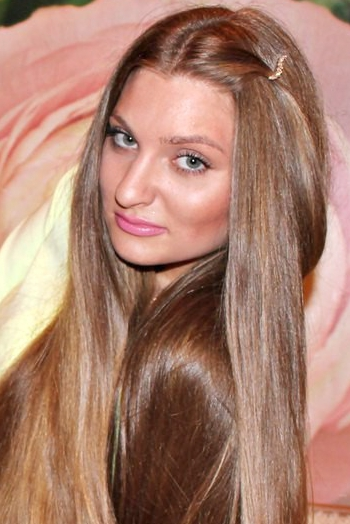 Ukrainian girl Julia,26 years old with grey eyes and light brown hair.