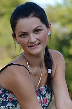 Ukrainian girl Nina,22 years old with brown eyes and black hair.