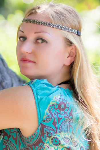 Ukrainian girl Marina,28 years old with green eyes and auburn hair.
