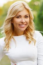 Ukrainian girl Yana,33 years old with hazel eyes and blonde hair.