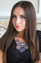 Ukrainian girl Anna,23 years old with hazel eyes and light brown hair.