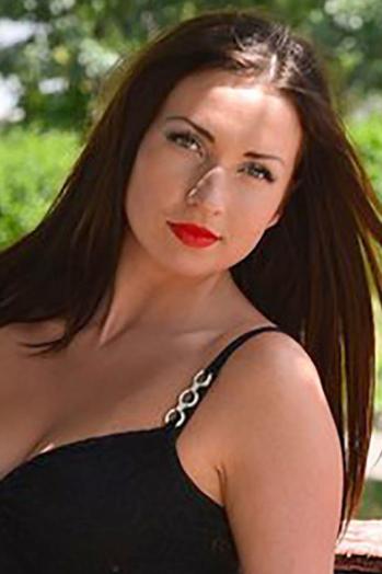 Ukrainian girl Kristina,24 years old with grey eyes and dark brown hair.