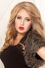 Ukrainian girl Tatiana,25 years old with grey eyes and blonde hair.