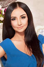 Ukrainian girl Olga,29 years old with hazel eyes and black hair.