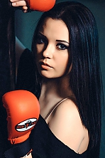 Ukrainian girl Nadezhda,24 years old with brown eyes and black hair.