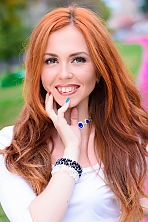 Ukrainian girl Anna,24 years old with green eyes and red hair.