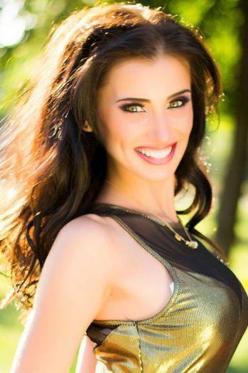 Ukrainian girl Tatiana,29 years old with green eyes and black hair.