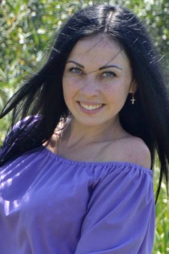 Ukrainian girl Dariya,27 years old with blue eyes and black hair.