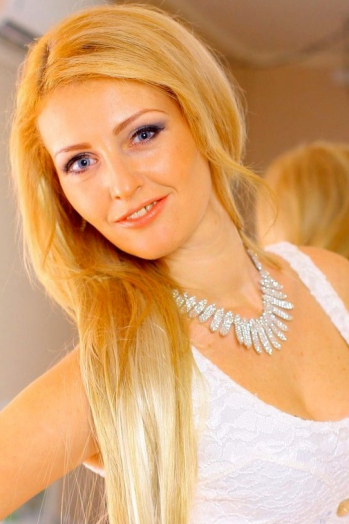 Ukrainian girl Marina,35 years old with blue eyes and blonde hair.