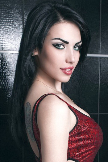 Ukrainian girl Victoria,22 years old with blue eyes and black hair.