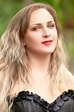 Ukrainian girl Inessa,30 years old with brown eyes and light brown hair.