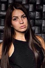 Ukrainian girl Olya,25 years old with brown eyes and black hair.