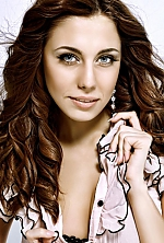 Ukrainian girl Elena,27 years old with blue eyes and dark brown hair.