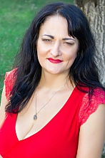 Ukrainian girl Larisa,42 years old with grey eyes and black hair.