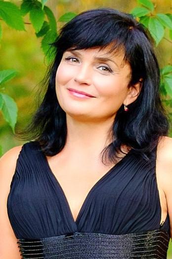 Ukrainian girl Tatyana,56 years old with green eyes and dark brown hair.