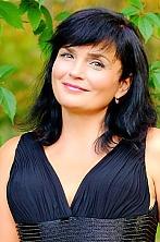 Ukrainian girl Tatyana,55 years old with green eyes and dark brown hair.