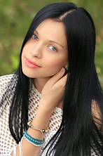Ukrainian girl Tanya,30 years old with blue eyes and black hair.