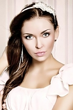 Ukrainian girl Marina,27 years old with blue eyes and dark brown hair.