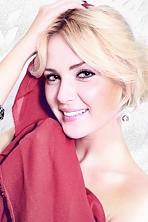 Ukrainian girl Elena,28 years old with hazel eyes and blonde hair.