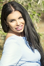 Ukrainian girl Alice,26 years old with blue eyes and black hair.