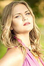 Ukrainian girl Daria,23 years old with green eyes and blonde hair.