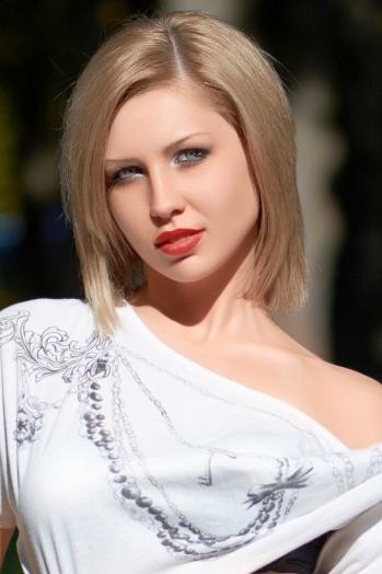 Ukrainian girl Anastasiya,22 years old with blue eyes and dark brown hair.