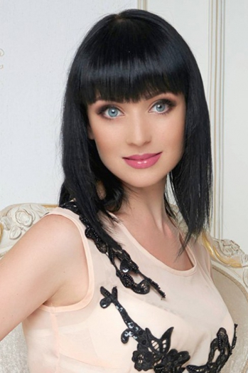Ukrainian girl Elena,33 years old with blue eyes and black hair.