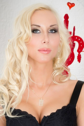 Russian girl Alena,28 years old with blue eyes and blonde hair.