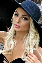Ukrainian girl Viktoria,23 years old with green eyes and blonde hair.