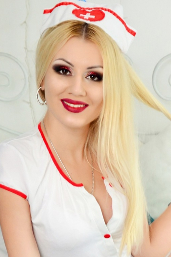 Ukrainian girl Marina,28 years old with brown eyes and blonde hair.