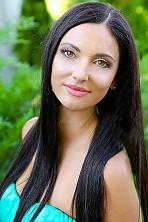 Ukrainian girl Elena,33 years old with green eyes and light brown hair.