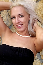 Ukrainian girl Ana,36 years old with green eyes and blonde hair.