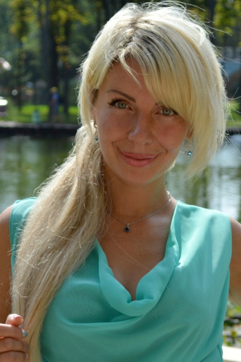 Ukrainian girl Olga,38 years old with  eyes and  hair.