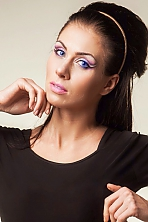 Ukrainian girl Irina,24 years old with blue eyes and dark brown hair.