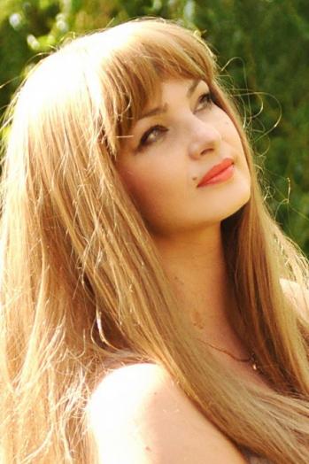 Ukrainian girl Nataliya,47 years old with  eyes and  hair.