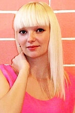 Ukrainian girl Oksana,31 years old with green eyes and blonde hair.