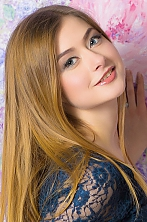 Ukrainian girl Olga,25 years old with hazel eyes and light brown hair.
