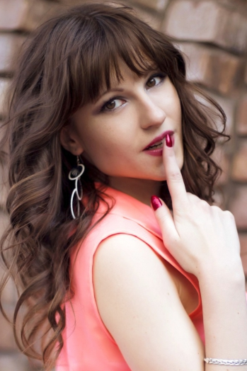 Ukrainian girl Alexandra,27 years old with green eyes and light brown hair.