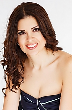 Ukrainian girl Kate,35 years old with brown eyes and dark brown hair.