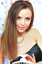Ukrainian girl Nataliya,30 years old with green eyes and light brown hair.