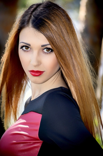 Ukrainian girl Alina,22 years old with brown eyes and red hair.
