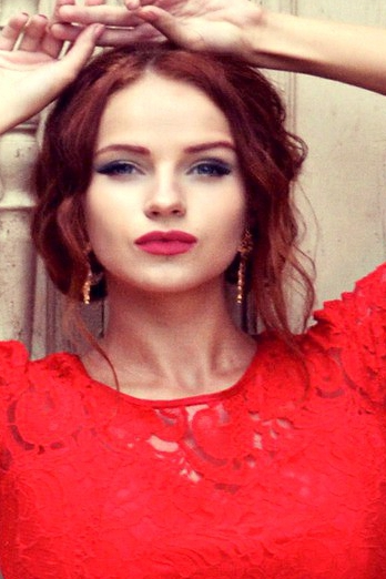 Ukrainian girl Lyubov,24 years old with grey eyes and red hair.